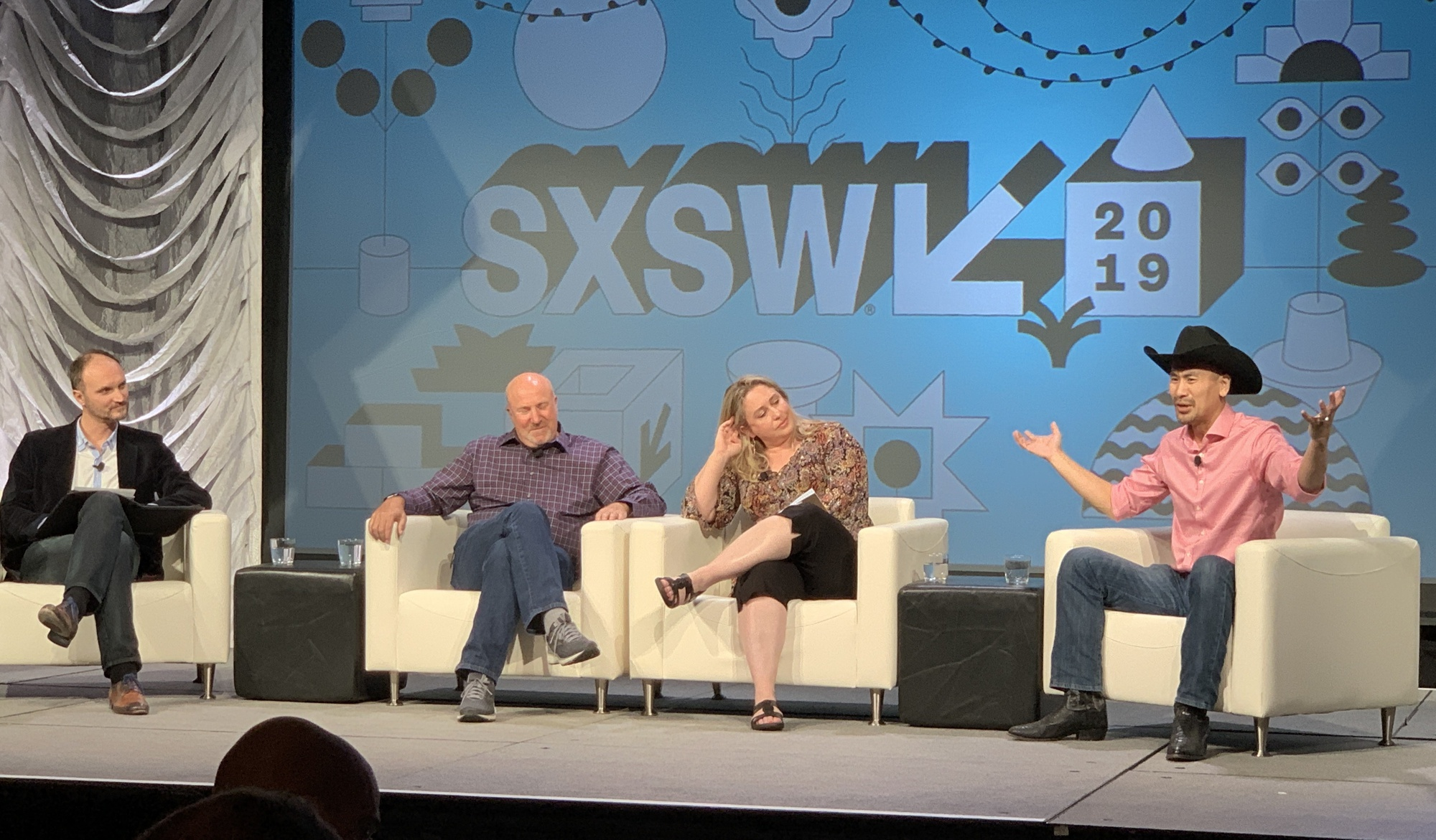The Blockchain Deathmatch at SXSW in action. From left to right: University of Texas at Austin's Cesare Fracassi, IBM OpenTech's Christopher Ferris, St. Mary's University School of Law's Angela Walch, and Bitcoin Core developer Jimmy Song (photo by Omar L. Gallaga for Modern Consensus).